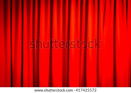 Red closed curtain with a light spot use for background - stock photo