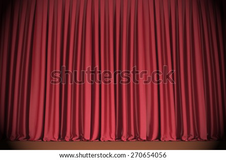 Red closed the curtain, lit by a spotlight - stock photo