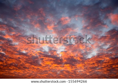 red cloudscape by sunset