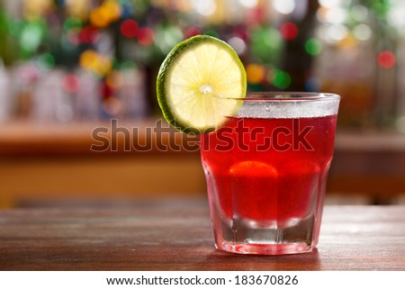 red cocktail in a bar - stock photo