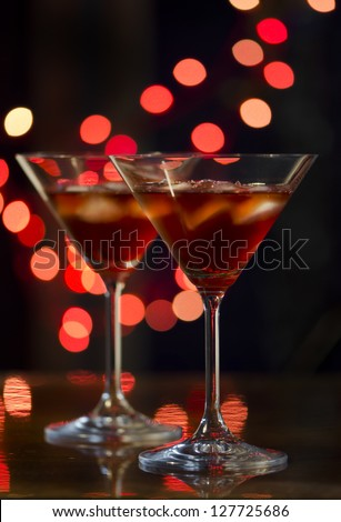 Red cocktail in martini glasses - stock photo