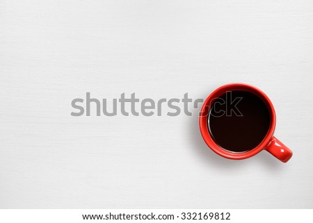 Red coffee cup on white table top view - stock photo