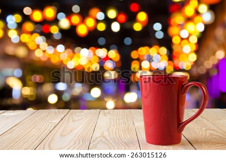 red coffee cup with night bokeh background - stock photo
