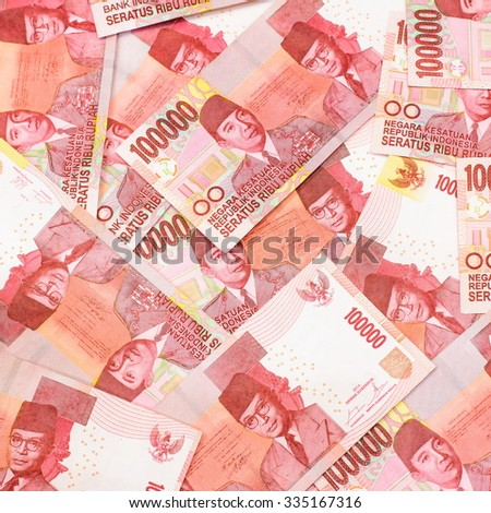 Red color of one hundred thousand  Indonesia Rupiah currency,money got profit from business - stock photo