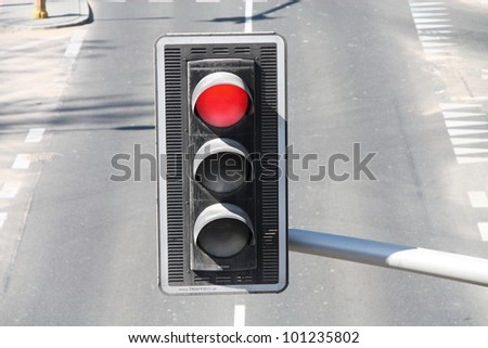 Red color on the traffic light.