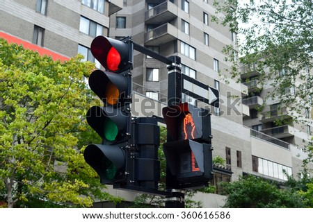 Red color on the traffic light in Montreal downtown. - stock photo