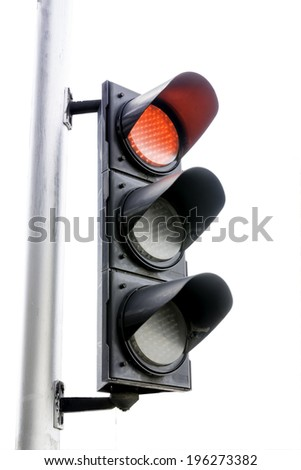 Red color on the traffic light isolated on white background - stock photo