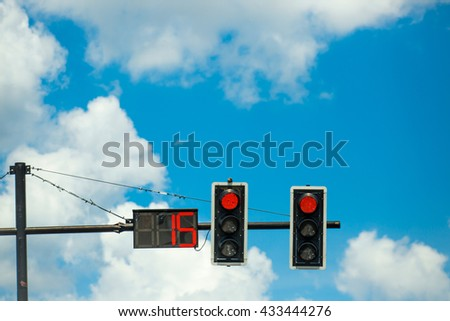 red color on the traffic light with a beautiful blue sky,red color on the traffic light with count down - stock photo