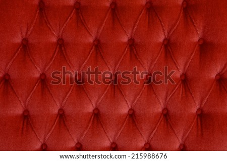 Red Color Velvet leather texture from sofa - stock photo