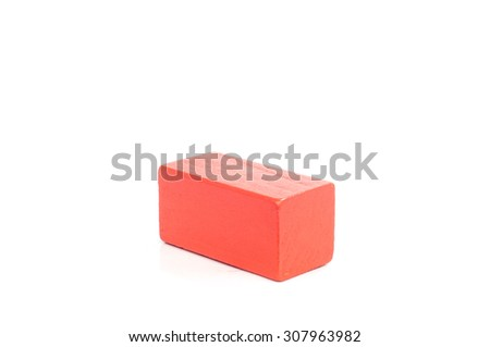 Red colored wooden blocks, building construction bricks over white background