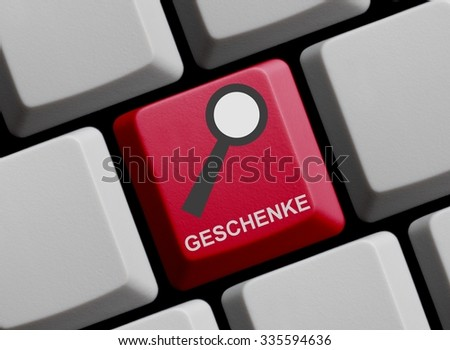 Red Computer Keyboard with symbol of magnifier with Presents in german language - stock photo