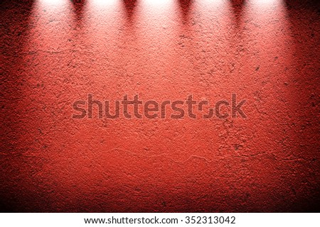red concrete wall with spotlight - stock photo