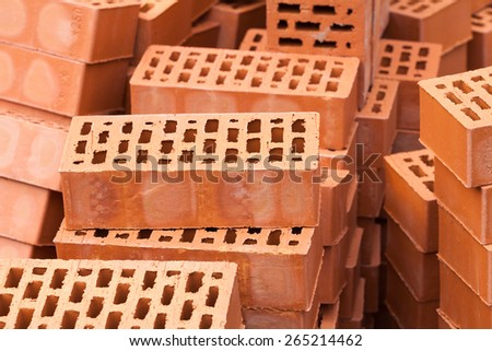 Red Construction Bricks Stones Pile Stacks - stock photo
