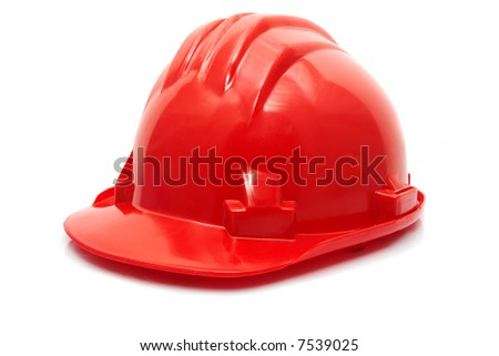 Red construction helmet or hat isolated on white with gentle shadow.
