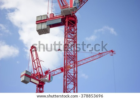 Red Construction Tower Cranes - stock photo