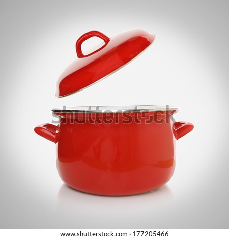Red cooking pot on grey background - stock photo
