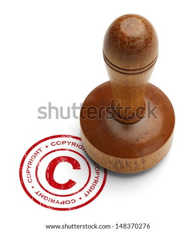 Red Copyright Stamp with Wooden Stamper Isolated on White Background. - stock photo