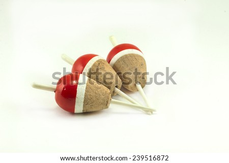 Red corks for fishing isolated white background - stock photo