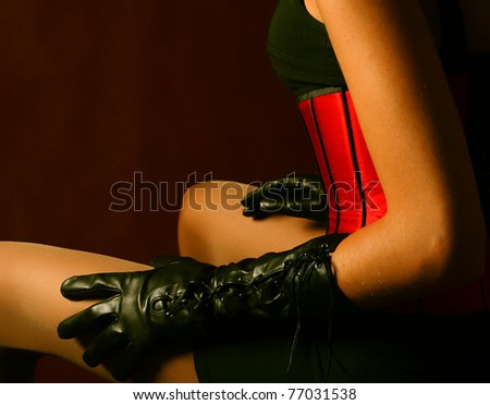 Red corset and black gloves - stock photo