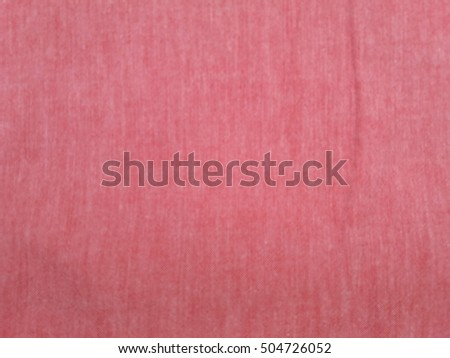 Red cotton fabric texture useful as a background