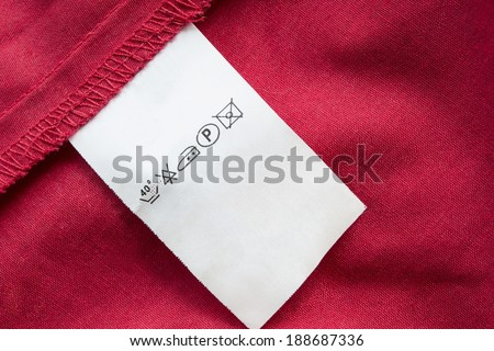 Red cotton with white washing instructions label