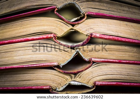 red covered opened old books - stock photo