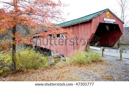 red covered wooden bridge (1836) in Taftsville, Vermont, USA - stock photo