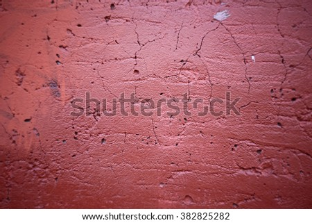 Red cracked concrete wall background