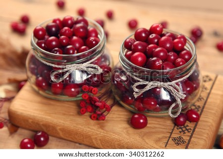 red cranberry on wooden table - stock photo