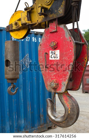 Red Crane Hook 25t isolated  An hoist on top industry place . Big metal hook with chain isolated      - stock photo