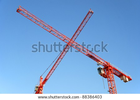 Red Cranes crossing at a construction site - stock photo