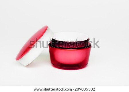 red cream jars on a white background, container cosmetic cream on a white background