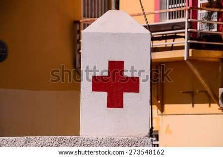 Red Cross Medical Sign Over a White Background - stock photo