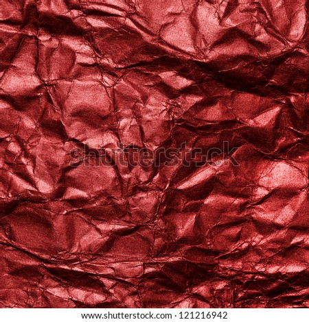 red crumpled metallic surface