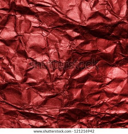 red crumpled metallic surface - stock photo