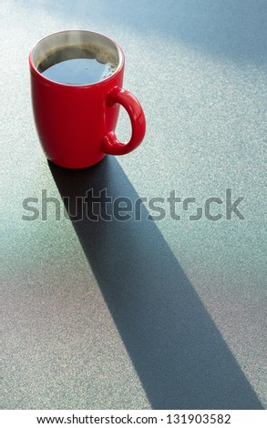 Red cup of coffee on the table - stock photo