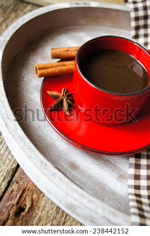 Red cup of coffee with coffee beans and spices cinnamon and anise star - stock photo