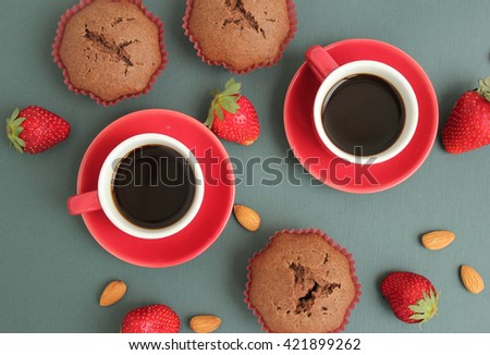 Red Cup with coffee. Homemade sweet muffins, strawberries. - stock photo