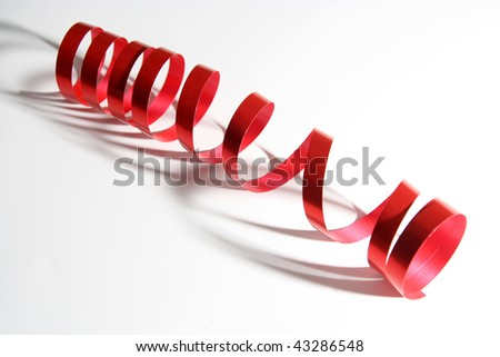 Red curled up Christmas ribbon