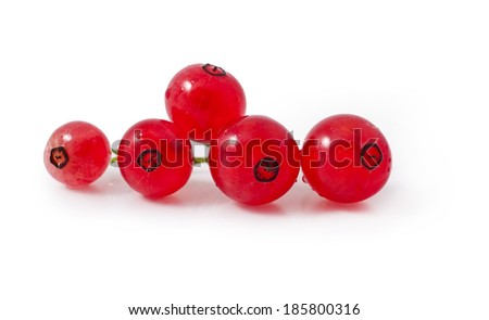 Red currant berries isolated on white background, close-up