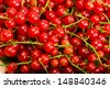 Red currant berry close up colorful fruit background  - stock photo