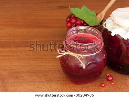 red currant jam in glass pots