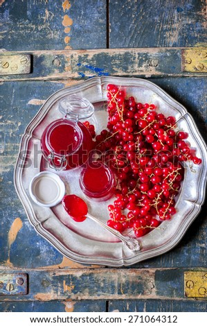 Red currant jam with fresh red currant, selective focus - stock photo