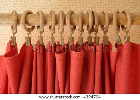 red curtain at holder rings - stock photo