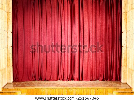 Red curtain at the theater, wooden stage with steps - stock photo