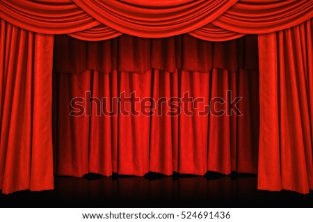 Red curtains and wooden stage floor.