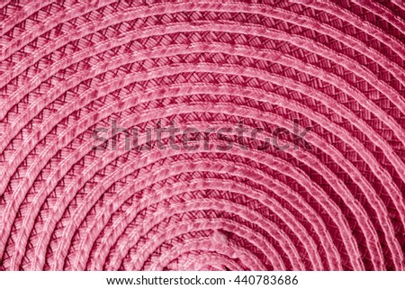 Red, curved woven material - stock photo