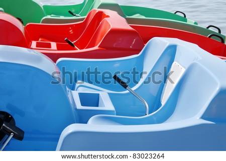 Red, dark blue and green catamarans - stock photo