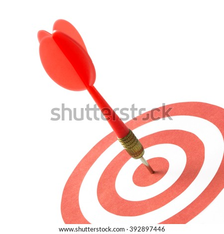 Red dart hitting on target center isolated on white - stock photo
