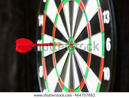 Red Dart in Bulls Eye Center of Board